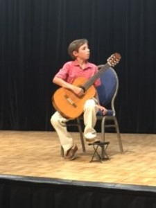 Aaron Marshall (9) performing at his first guitar competition. At Tarrant County College.
